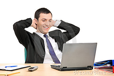 Satisfied businessman looking at his laptop