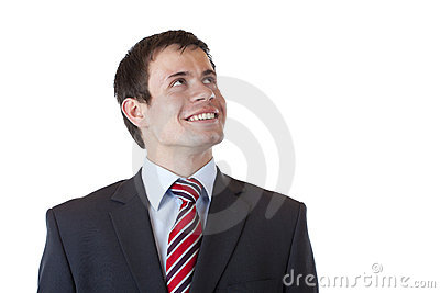 Satisfied businessman looks into future confident