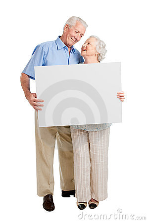 Satisfied old couple with sign