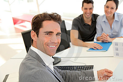 Satisfied real estate agent with customers