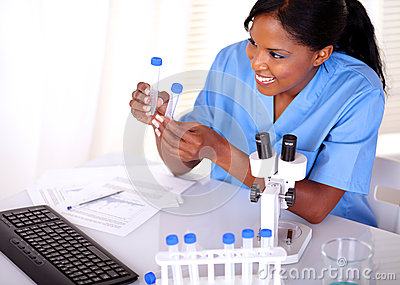 Satisfied scientific woman looking to test tube