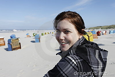 Satisfied woman at the beach