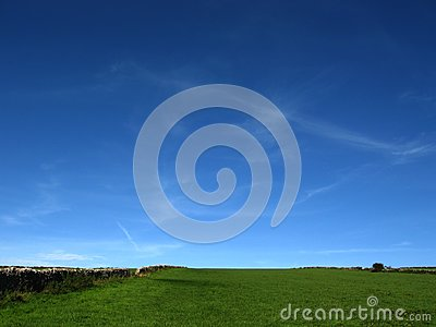 Saturated blue sky and green field