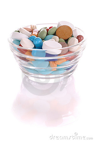 Saucer with many-colored pills