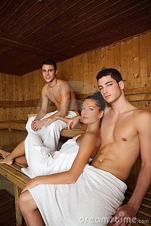 Sauna spa therapy young group in wooden room