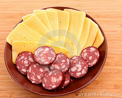Sausage and cheese on plate isolated