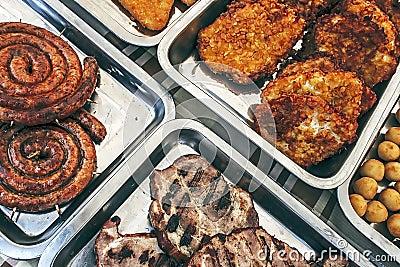 Sausage, ham, schnitzel and potatoes