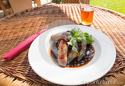 Sausage and mash with gravy in english pub