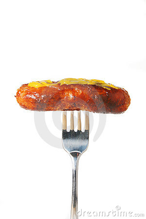 Sausage with mustard on fork