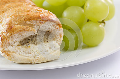 Sausage roll and grapes