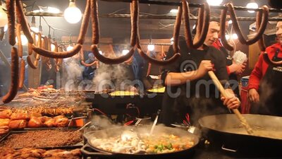 Sausage stall at the Christmas market at Rynek Glowny square in Krakow, Poland stock video
