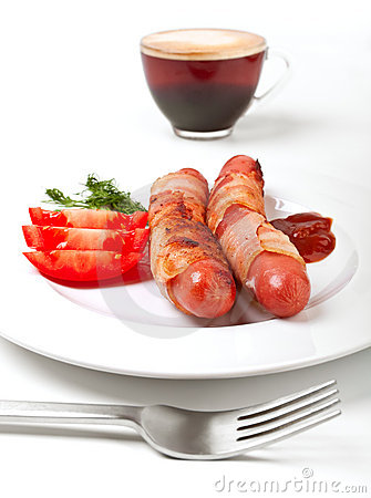Sausages in bacon, coffee, tomatoes