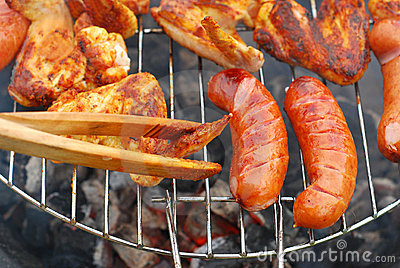 Sausages and chicken wings on the grill