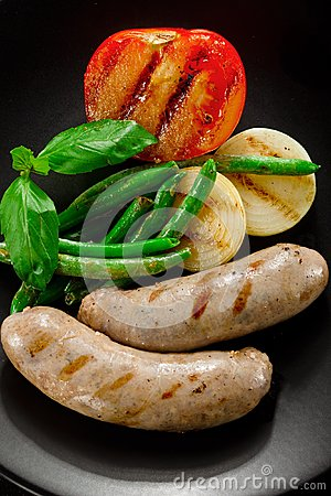 Sausages and fried tomatoes