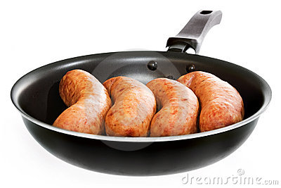 Sausages in frying pan