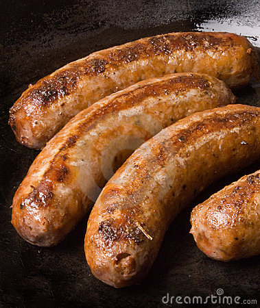 Free Sausages In A Black Frying Pan Stock Images - 1700494