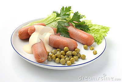 Sausages on a white dish