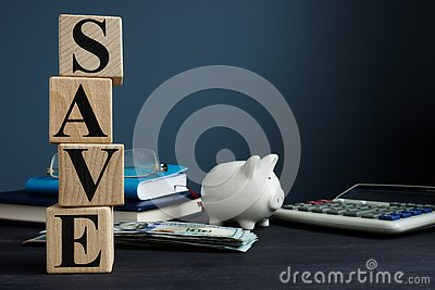 Save from cubes and piggy bank. Money savings concept. Stock Photo