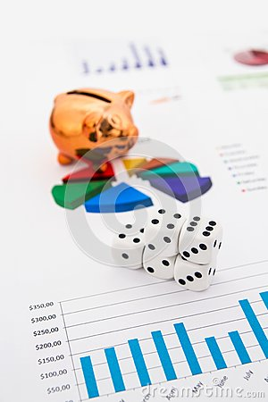 Saving money. Gambling concept.Pig, coins and dices.