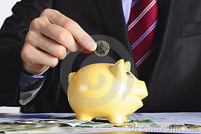 Saving money in the piggybank
