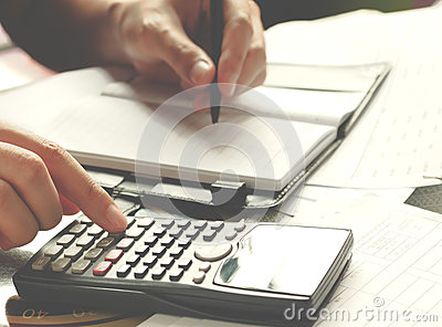 Savings, finances, economy and home concept - close up of man with calculator counting making notes at home Stock Photo