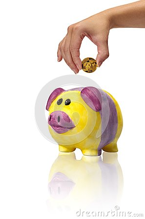 Savings in piggybank with gold coins