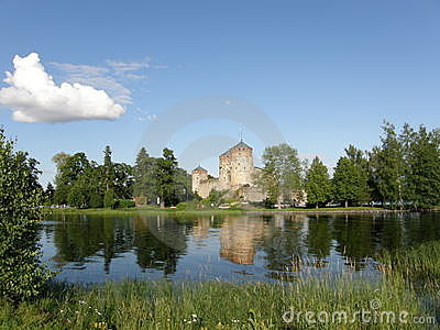 Savonlinna castle and its reflection in the lake