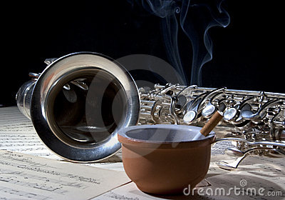 Saxophone cigarette and old sheet music