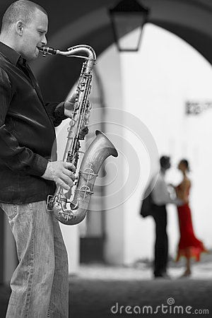 Free Saxophone Player With Romantic Couple Royalty Free Stock Image - 34523766