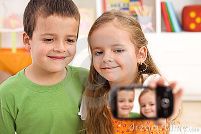 Say cheese - kids taking a photo of themselves