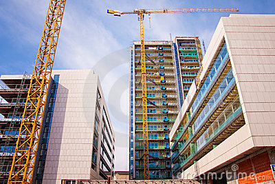 Scaffolds and cranes at construction site