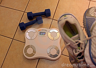 Scale, dumbbells and shoes