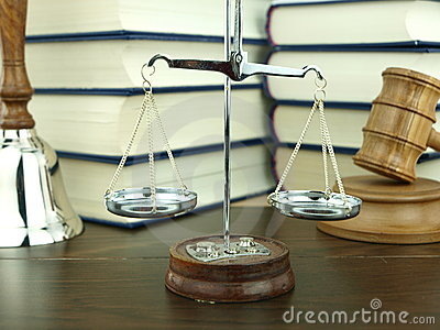Scale of justice, hand bell and judges gavel