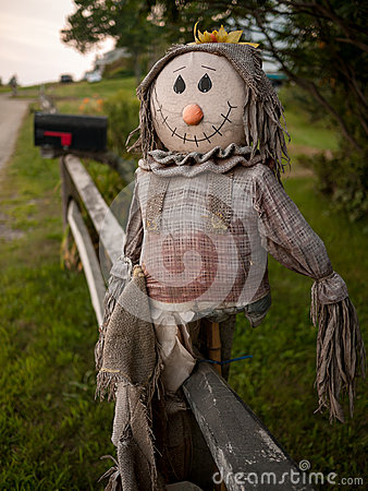 Scarecrow on a Fence