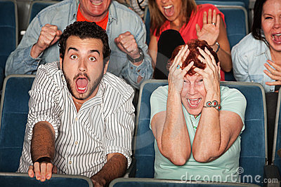 Group Of Seven Scared Audience Members Cringe In Their Seats Stock ...
