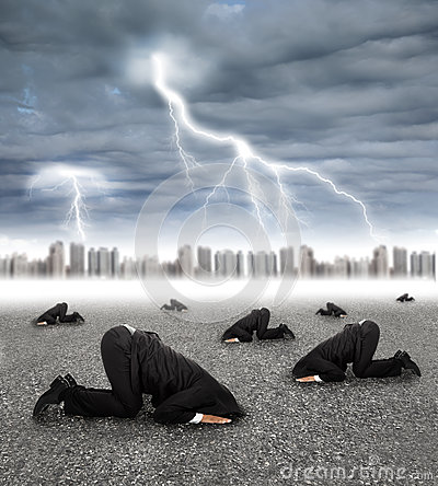 Scared businessman hiding on the ground with storm