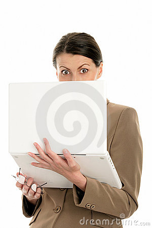 Scared businesswoman using laptop