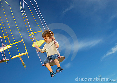Scared Child on fairground ride.