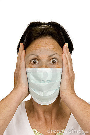 Frightened woman wearing surgical mask