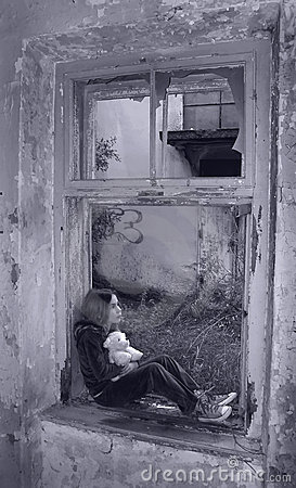 Scared girl on broken window