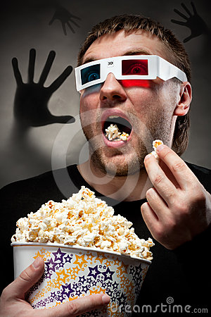 Scared Man Watching 3D Movie Royalty Free Stock Images - Image: 24285089