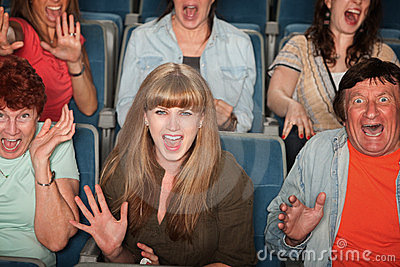 Pictures of Scared audience members in movie theatre - People in a ...