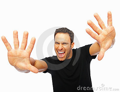 Scared young man with hands stretched forward