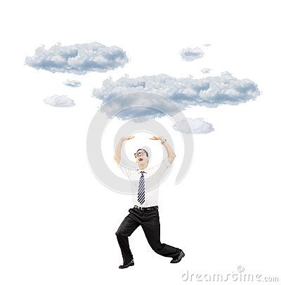 Scared young man protecting from falling clouds with his hands