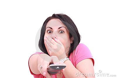 Scared young woman while watching TV