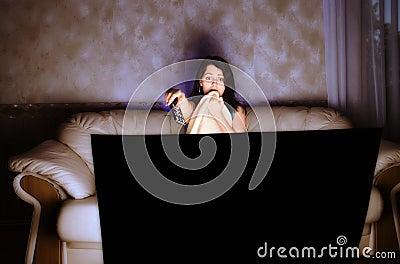 Scarred  beautiful girl watching TV