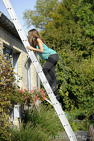 Scarred woman on a ladder