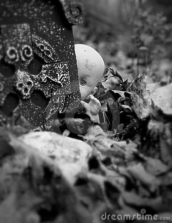 Scary doll in cemetery