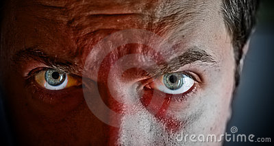 Scary eyes on face with blood