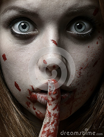 Free Scary Girl And Halloween Theme: Portrait Of A Crazy Girl With A Bloody Face In The Studio Royalty Free Stock Photography - 61055427